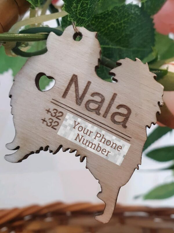 Wooden keychain by Nala