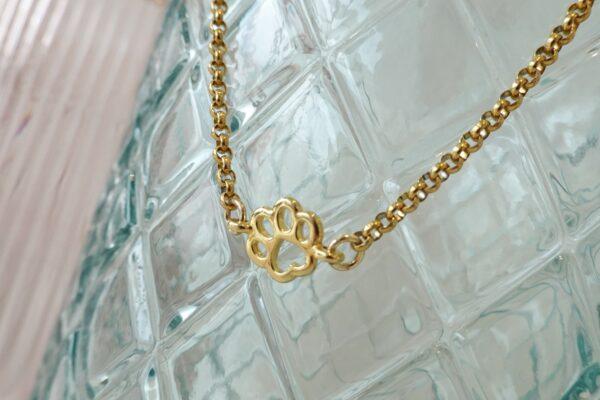golden necklace dog paw